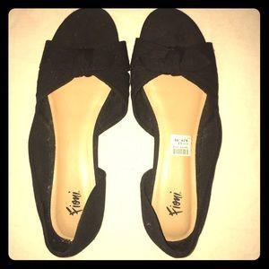 Brand new black & tan flats w\ black bow.